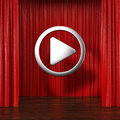 Red curtains with play button