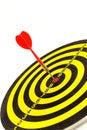 Red darts in bullseye of dartboard arrows Stock Image
