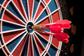 Red darts and dartboard Royalty Free Stock Photo