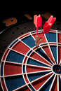 Red darts and dartboard Stock Photography
