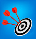 Red darts hitting a target. Success concept. Stock Images