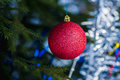 Red decoration ball which dangles on the christmas tree closeup view of a horisontal format photo Stock Photos