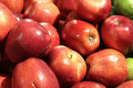 Red delicious apples plentiful ripe at a frame market Royalty Free Stock Photos