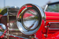 Red detail on the headlight of a vintage car Royalty Free Stock Photo