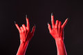 Red devil hands showing heavy metal halloween or music theme Royalty Free Stock Photography