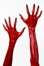 Red devil s hands with black nails red hands of satan halloween theme on a white background isolated studio Stock Photo