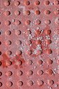 Red diamond plate closeup texture with dirt and grime Royalty Free Stock Photo