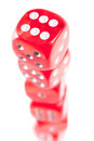 Red dice arranged as a tower on white background Stock Image