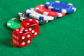 Red dice on a casino table with chips colorful Stock Photography