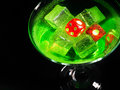 Red dice in a cocktail glass on black background. casino series Royalty Free Stock Photo
