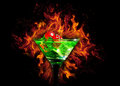 Red dice in a cocktail glass on Fire background. casino series Royalty Free Stock Photo