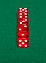 Red dice on green background closeup Royalty Free Stock Image