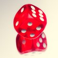 Red dice on a mirror Royalty Free Stock Photo