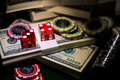 Red dices on chip and dollar bills, casino concept Royalty Free Stock Photo