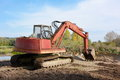 Red digger in nature Royalty Free Stock Photo