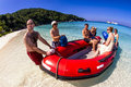Red dingy on beach Royalty Free Stock Photos