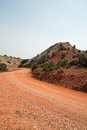 Red dirt and gravel Crooked Creek Road through the Pryor Mountains in Wyoming Royalty Free Stock Photo