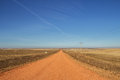 Red dirt roads in the countryside rural north dakota Royalty Free Stock Photo
