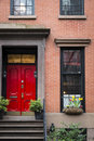 Red door apartment building new york city to an manhattan Stock Photography
