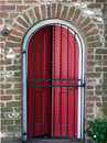 Red Door behind Iron Gate Royalty Free Stock Photo
