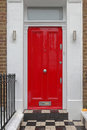 Red door entrance with doorknob and transom window Stock Images