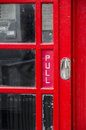 Red door of london phone box Stock Photography
