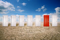 Red door among many white ones Royalty Free Stock Photo