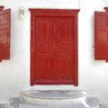 Red door mikonos island greece house entrance Royalty Free Stock Image