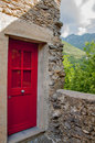 A red door in old village in liguria italy Stock Image