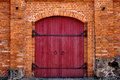 Red door in red brick wall Royalty Free Stock Photos