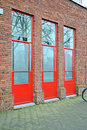 Red doors on the brick wall, building industry Stock Photography