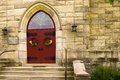 Red doors of a church stone steps lead to the entry the united christ in dorset vermont Royalty Free Stock Images