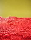 Red dotted pane pattern from the plastic pin toy selective focus Stock Photos