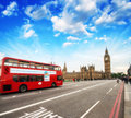 Red double decker bus in the heart of london westminster bridge Stock Image