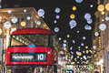 Red double decker bus in London during Christmas time Royalty Free Stock Photo