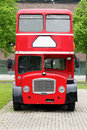 Red double decker bus on the street big Stock Photography