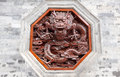 Red dragon carving on wall in an octagon Stock Photography