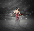 Red dress snow storm a woman in a standing in a Royalty Free Stock Photography