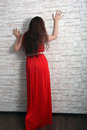 Red dress young girl in a long studio shoot Stock Image