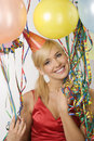 Red dressed girl in party with balloons Royalty Free Stock Photos