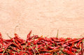 Red dried chili pepper on wooden background