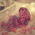 Red dried goji berries vintage retra style wolfberry or lycium chinese herbal medicine close up on bamboo mat lycium barbarum Stock Photo