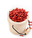 Red dried goji berries in wooden bucket. Royalty Free Stock Photo