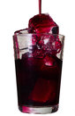 Red drink in a glass with ice cubes Royalty Free Stock Photo