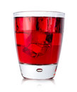 Red drink with ice cubes in a glass Royalty Free Stock Photo