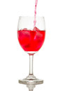 Red drink with ice cubes in a glass, Red soda in glass wine. Royalty Free Stock Photo