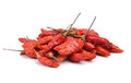 Red dry chillies on white background Royalty Free Stock Photo