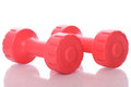 Red dumbells over white background Royalty Free Stock Photo