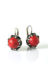 Red earring silver over white with shadows Royalty Free Stock Images