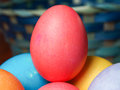 Red easter egg with a basket in the background Stock Images
